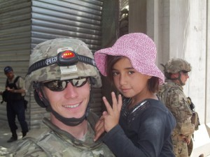 US Army medic with Afghan child