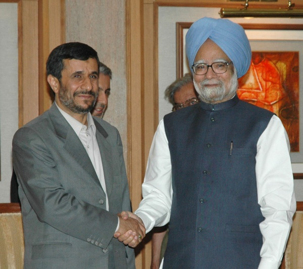 President Ahmedinejad and President Singh shaking hands